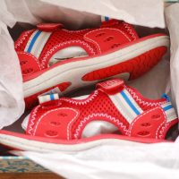 red_sandals_in_box