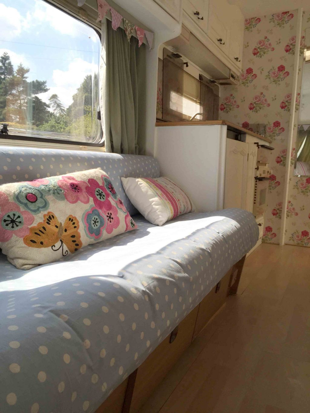 The sun coming through the window of Dolly the caravan. We used laminate on the floor and I covered the cushions with polkadot fabric. She looked so much fresher after her caravan makeover!! More info on both of my caravan makeovers on the blog!