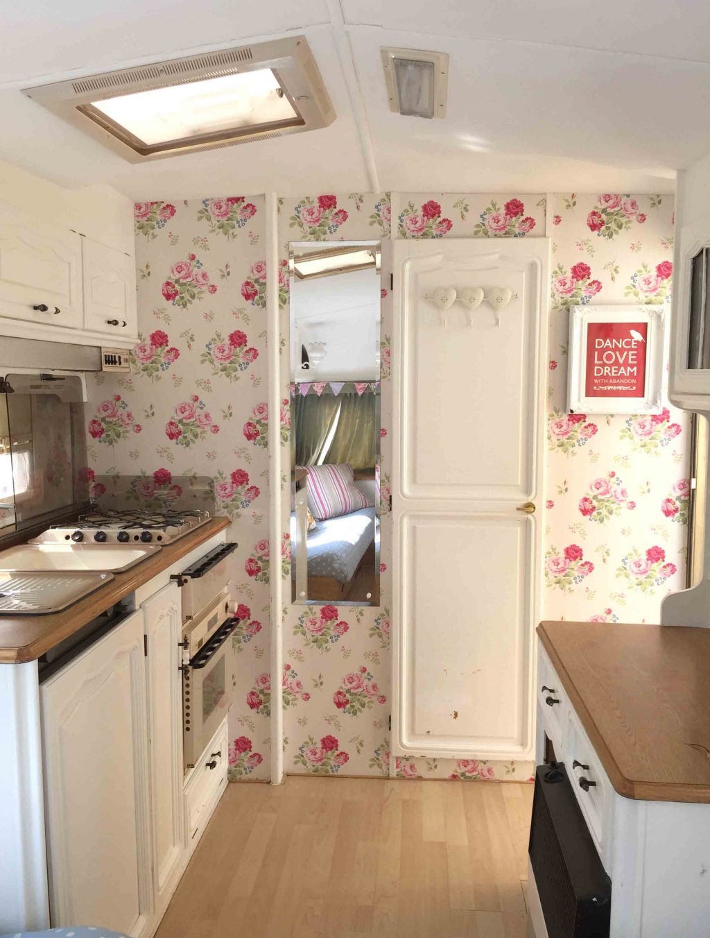 The living space in Dolly after her caravan makeover! I painted the ceiling and cupboards, and wallpapered the walls with Cath Kidston wallpaper. More info on both of my caravan makeovers on the blog!