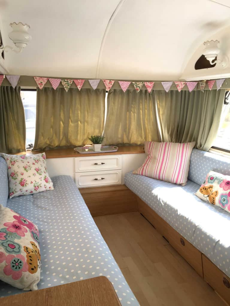 The interior of Dolly the caravan, after she had been painted as part of my first caravan makeover. I covered the seats in polkadot fabric and made shabby chic bunting. More info on both of my caravan makeovers on the blog!