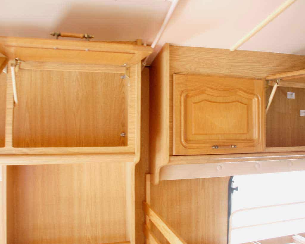 5 Tips on Buying a Second Hand Caravan — open cupboards to check for damp