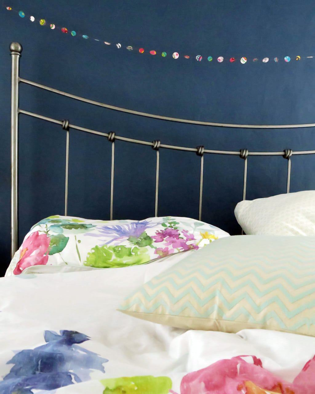 """A colourful bedroom makeover """" Navy walls and bright bedlinen from bluebellgray"""