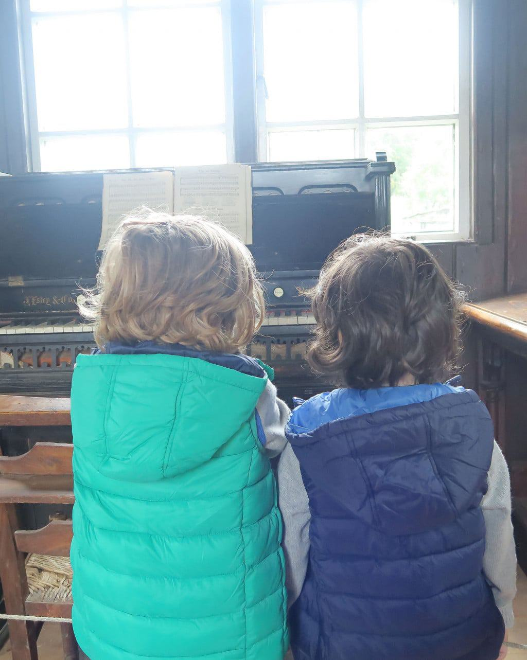 Bertie and Cosmo getting to grips with the organ at the Chiltern Open Air Museum