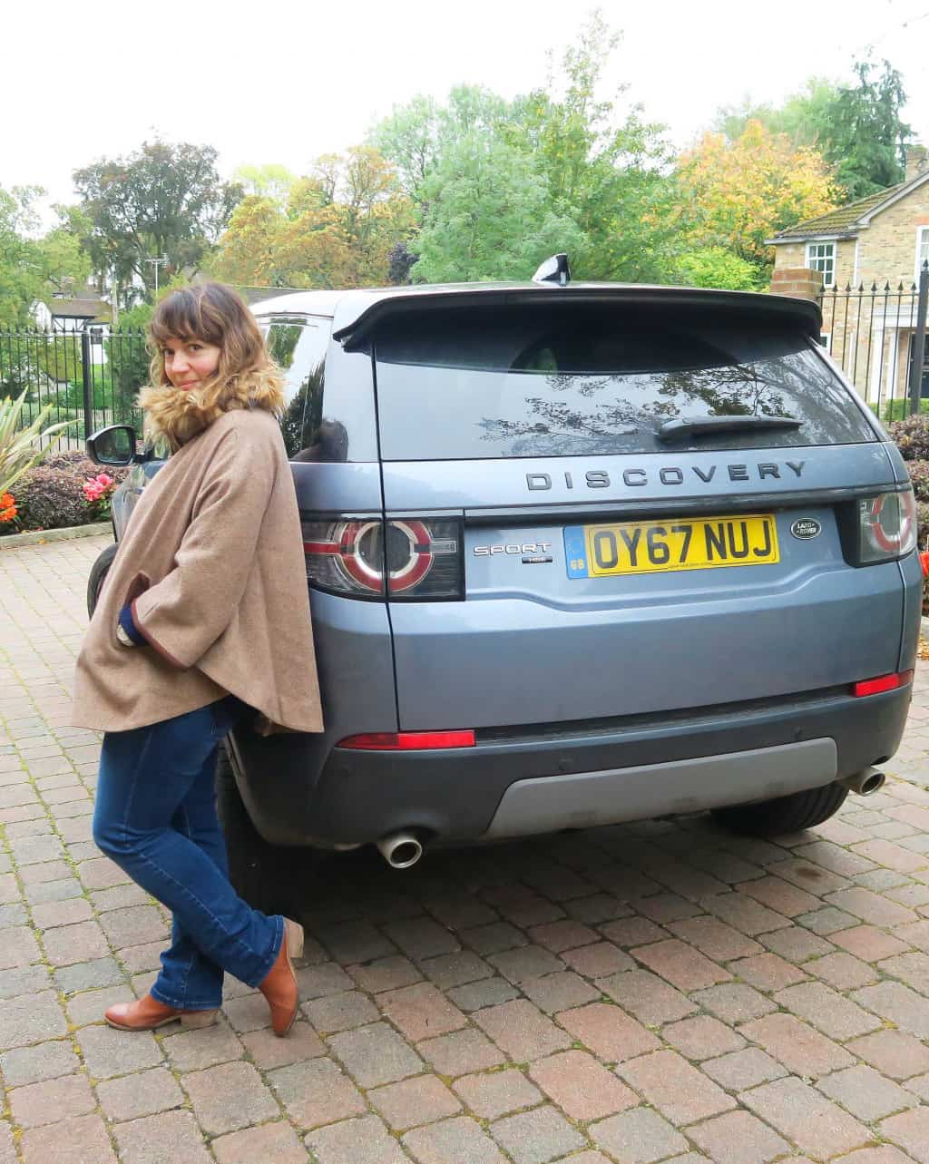 Caro standing by the  Discovery Sport HSE LUX