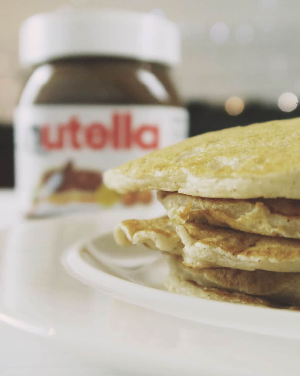 The Best Eggless Pancake Recipe EVER {Featuring Nutella} — stack of pancakes with Nutella