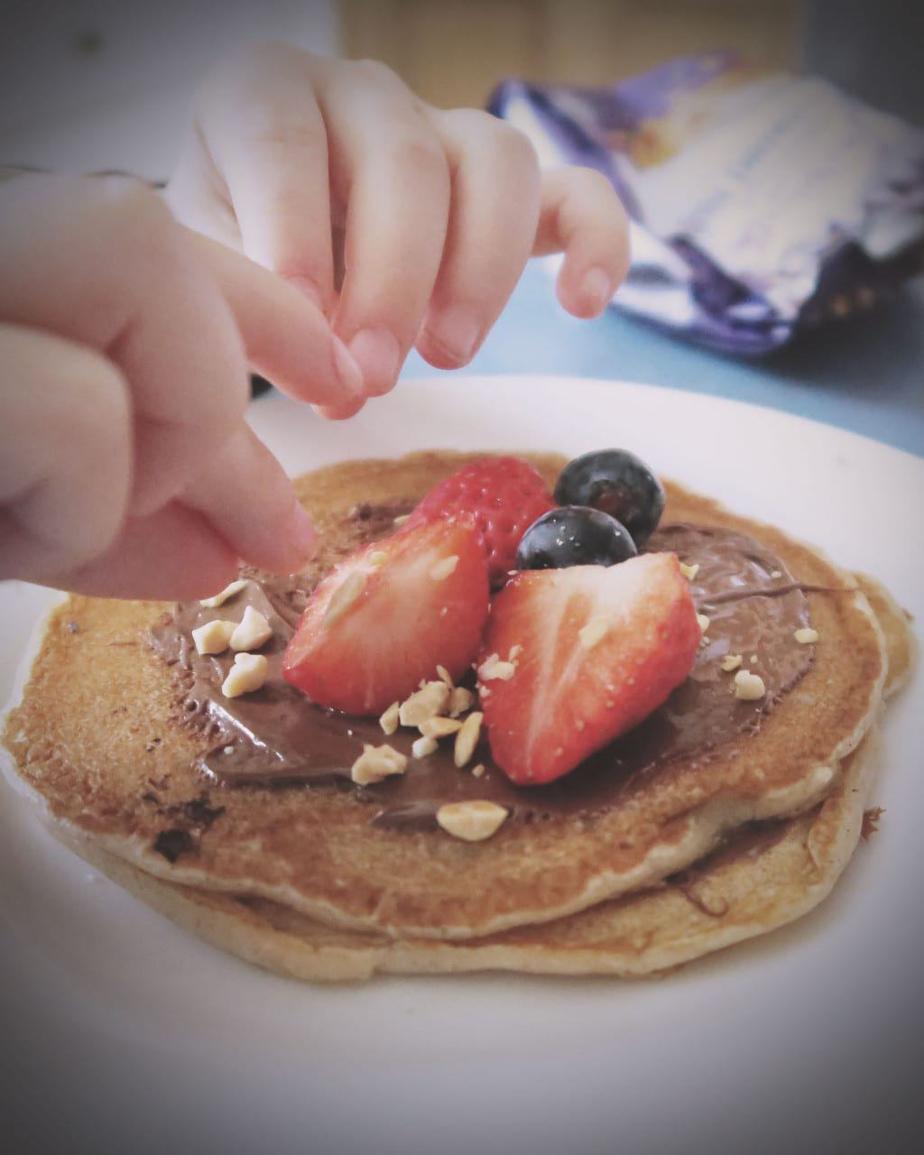 The Best Eggless Pancake Recipe EVER {Featuring Nutella} — sprinkling nuts