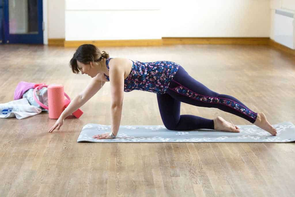 Pilates Kneeling Superman — Position 2 — Extend your left leg out behind your body — toes brushing the floor — whilst simultaneously extending the right arm. Hold the pose for a few seconds, until you feel balanced and strong.