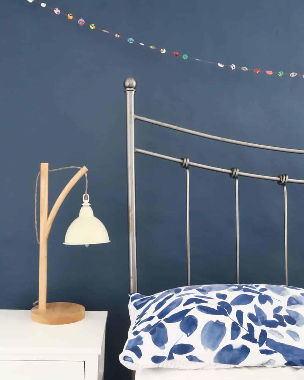 Deep navy blue walls in a bedroom — very restful.