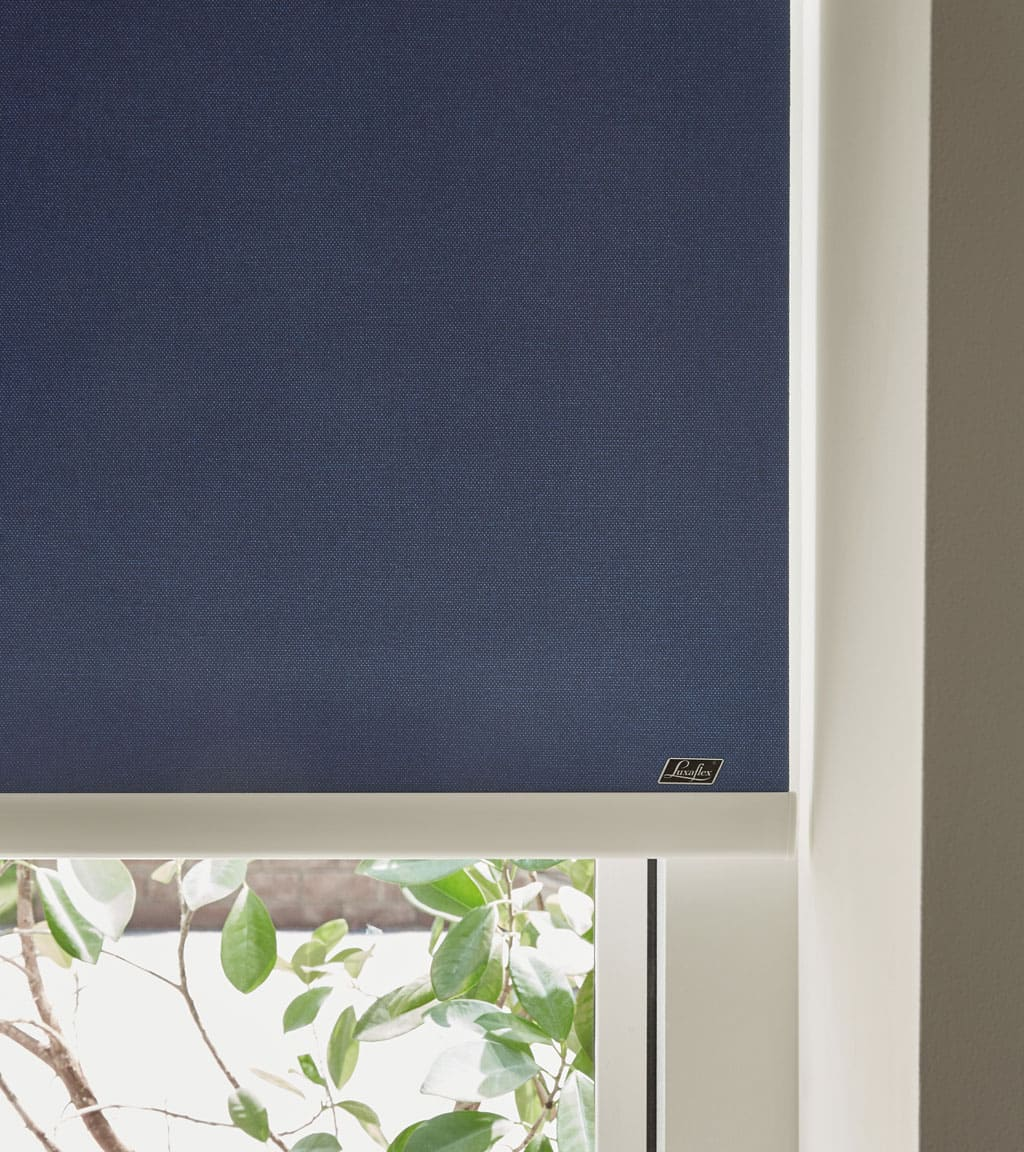 Navy roller blinds from Luxaflex