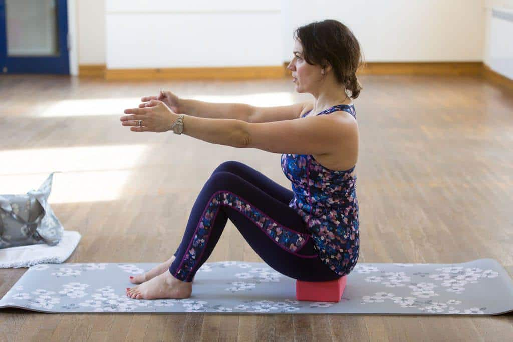 How Pilates Changed My Life   sitting bow and arrow on a block