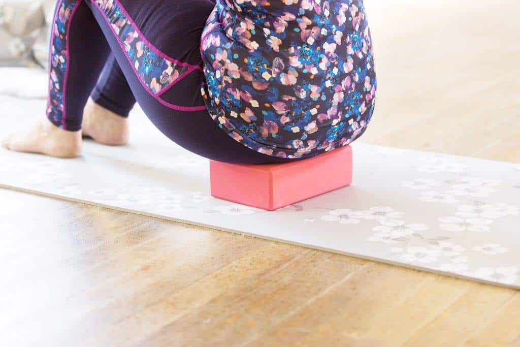 How Pilates Changed My Life   sitting on a block