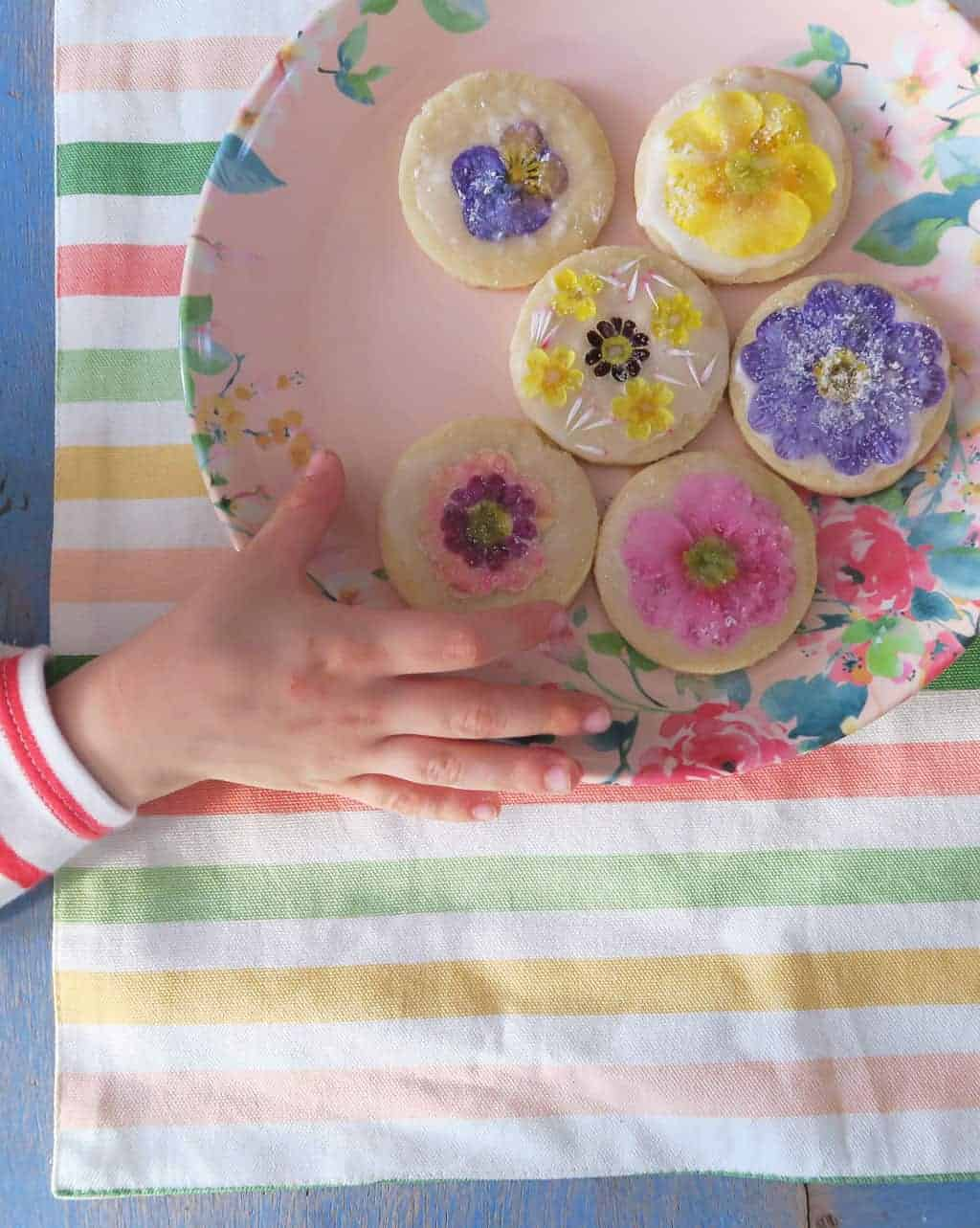 Edible flower biscuits on a floral melamine plate