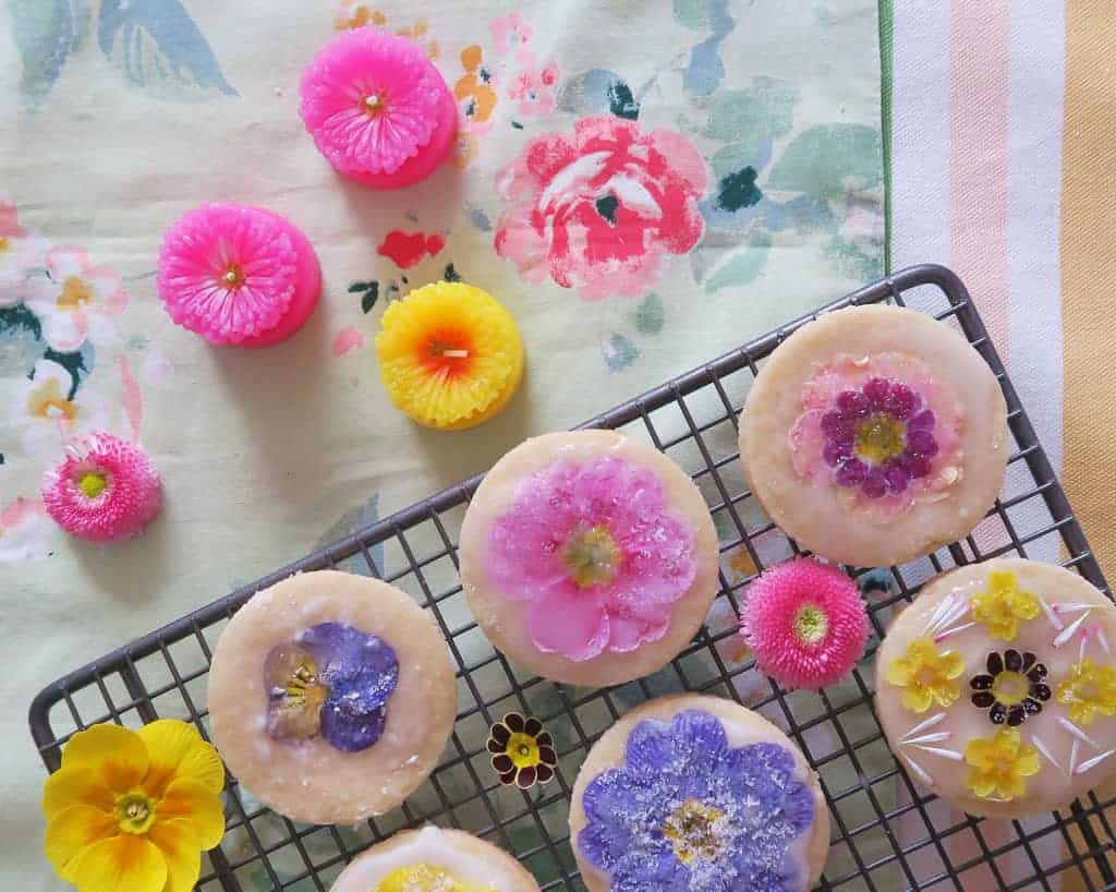 Edible flower biscuits on a wire rack
