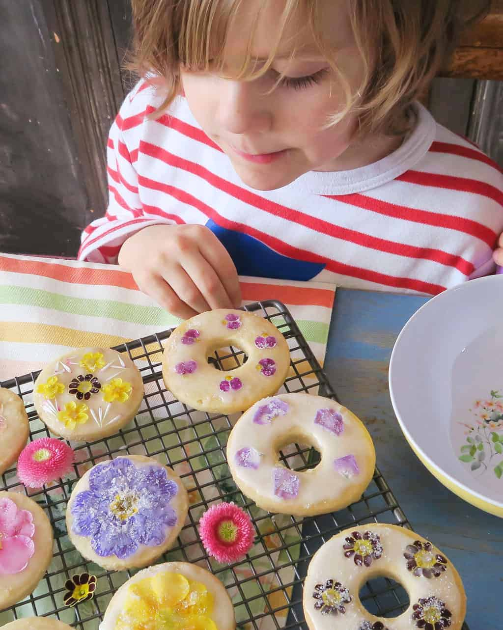 Edible flower biscuits drying on a cooling rack