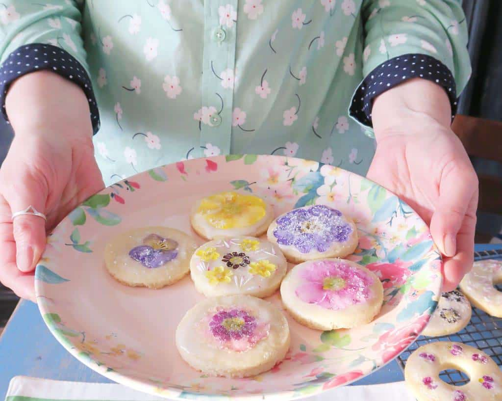 Edible flower biscuits presented on a floral melamine plate by Laura Ashley