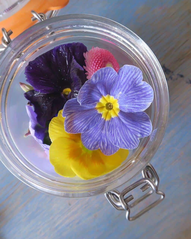 Beautiful edible flowers in a Kilner Jar — from Delicately Edible