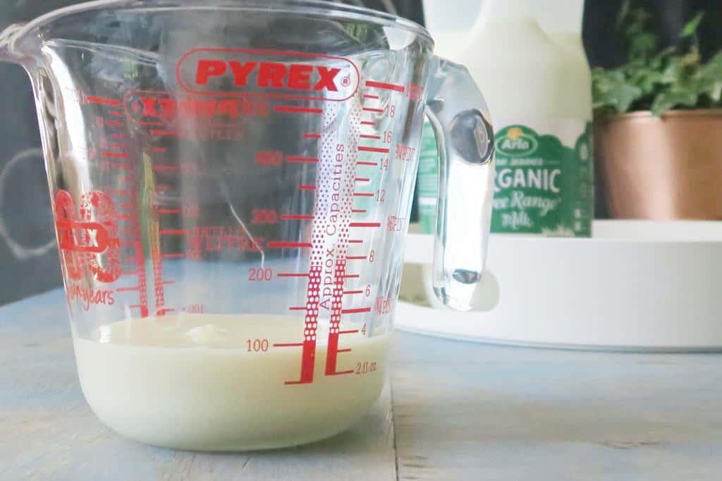 100ml of sweetened condensed milk in a jug