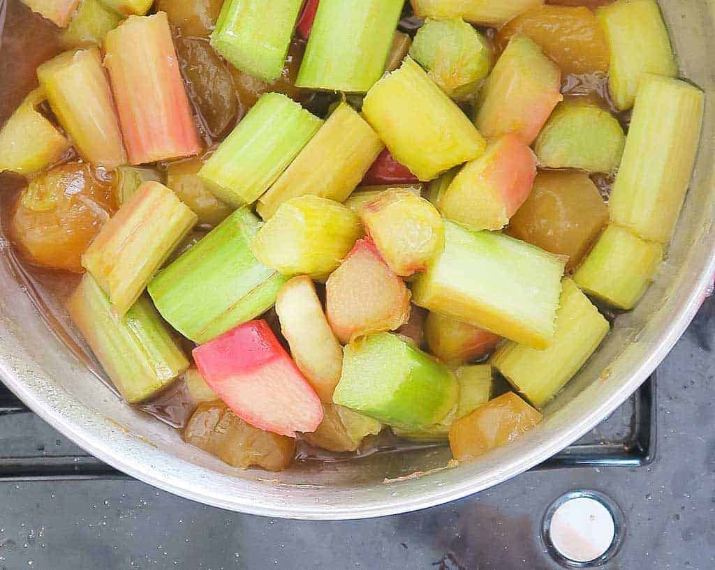 cooking rhubarb and ginger for homemade gin