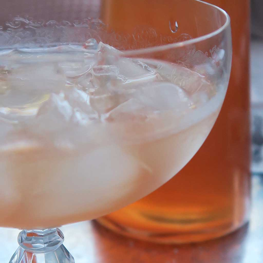 a glass of homemade ginger and rhubarb gin