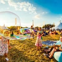 Kids playing with giant bubbles at Bluedot 2017