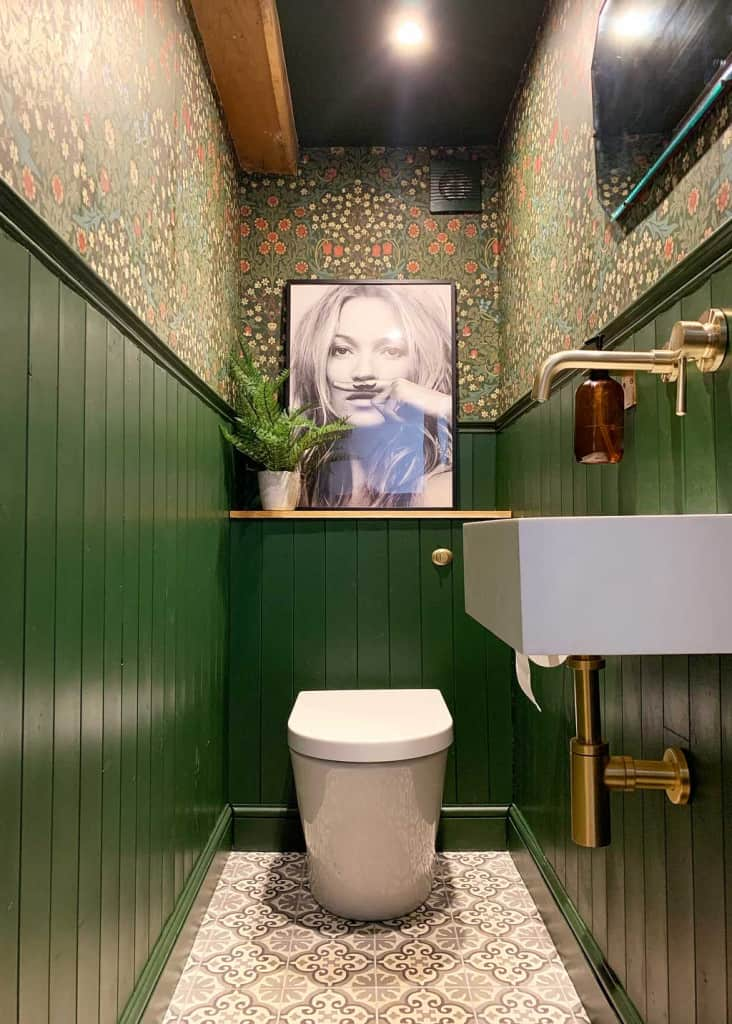 William Morris wallpapered toilet with green tongue and groove panelling
