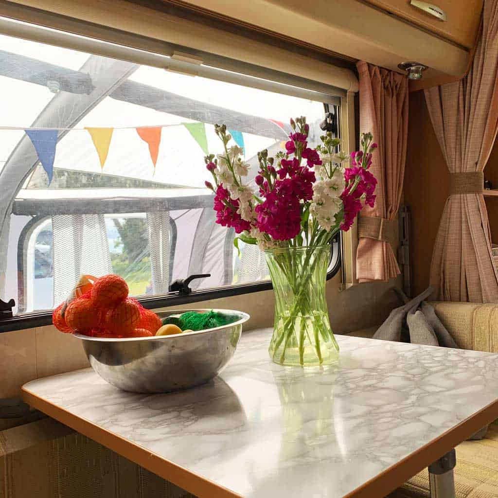 You can see OLPRO View 420 Caravan Inflatable Porch Awning through the window — it's doubled the living space of the caravan