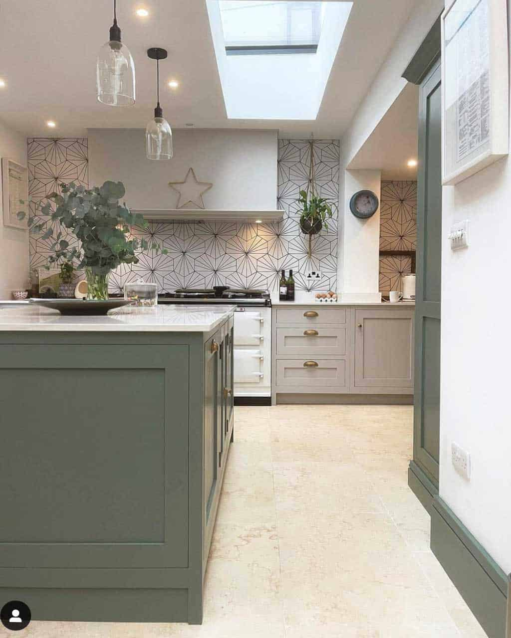 grey and green shaker kitchen with white aga