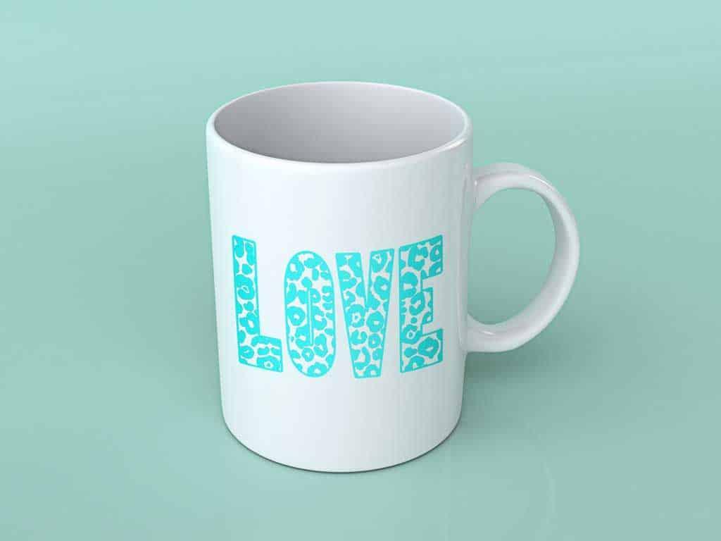 Leopard print letters on a mug