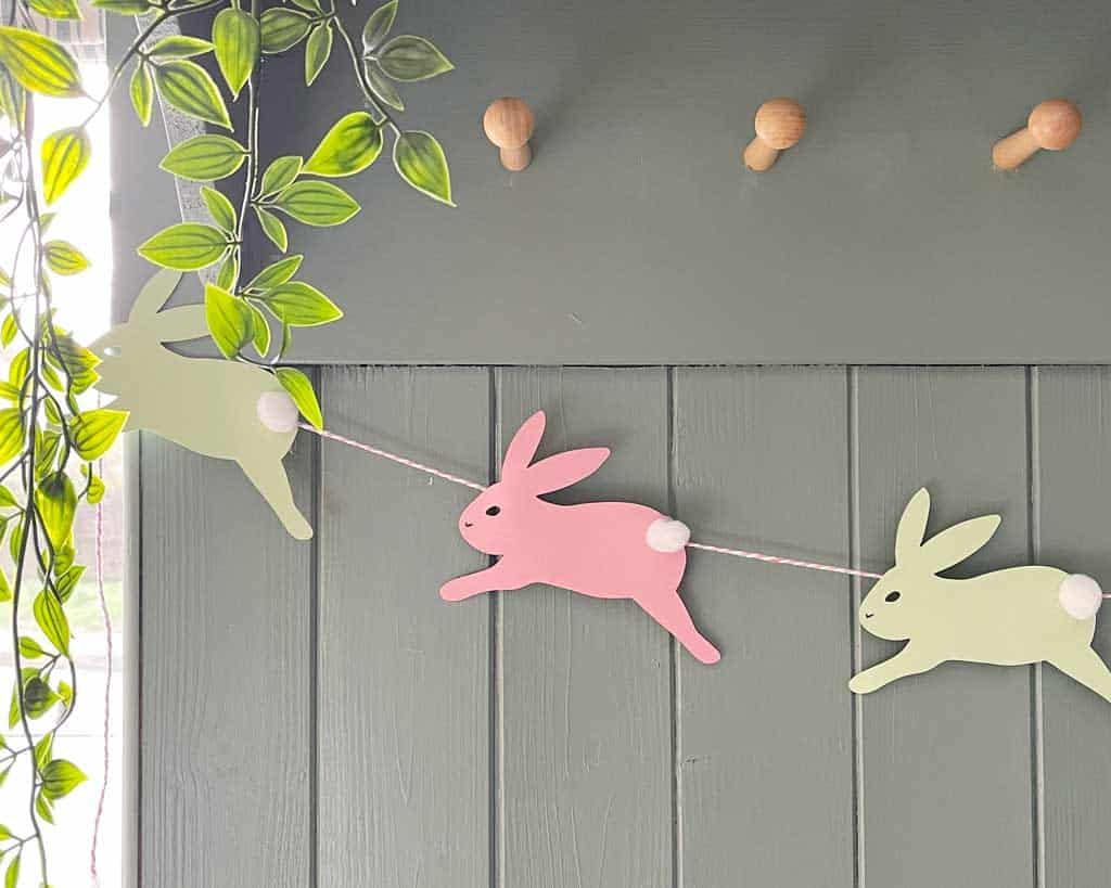 A Simple DIY Easter Bunny Garland With Pom Pom Tails