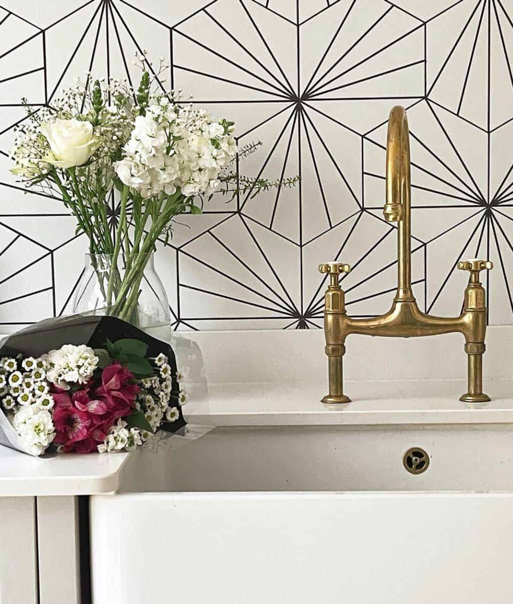 Lilypad tile splashback and aged brass Perrin and Rowe taps