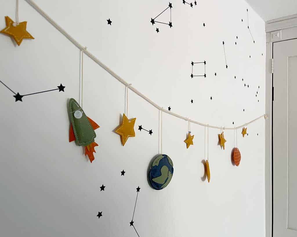 You can get themed space bedroom decor from all sorts of places — Etsy is always a good option for a space kids room