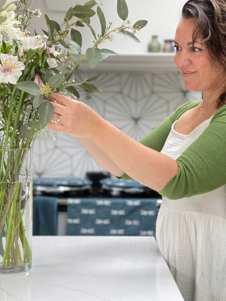 Faux flowers that look real mixed with fresh flowers are a great way of creating large, inexpensive, floral arrangements