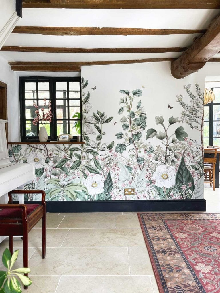Bespoke wall mural from Les Dominotiers in the The Listed Home hallway — with Monte Carlo limestone floor from Quorn Stone