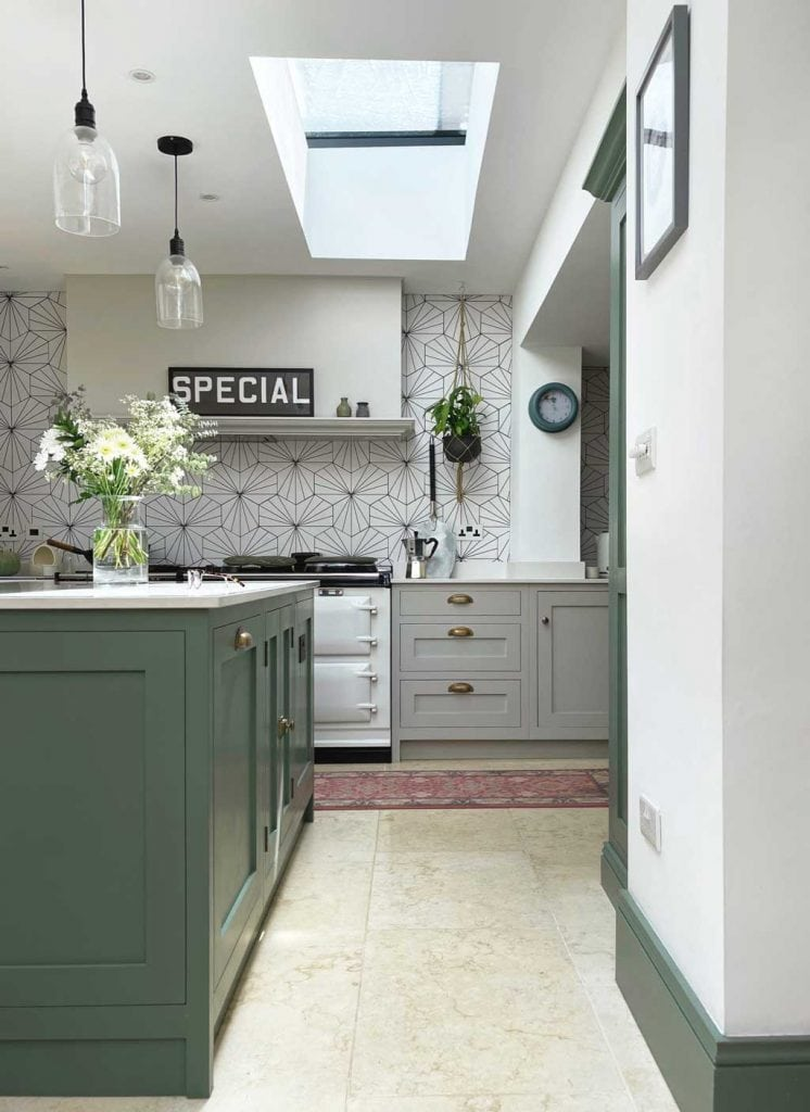 Green and grey kitchen in The Listed Home — with Monte Carlo limestone floor from Quorn Stone
